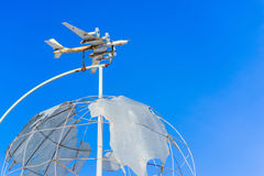 Monument. the plane is flying over the globe Royalty Free Stock Images