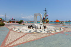 Monument and pleasure boats in the sea port of Alanya Royalty Free Stock Images