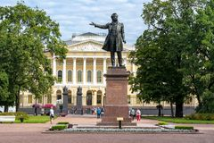 Monument for poet Alexander Pushkin on Culture square with Russian museum at background, St. Petersburg, Russia royalty free stock photos