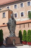 Monument of Pope John Paul II. Next to the Royal Archcathedral Basilica of Saints Stanislaus and Wenceslaus on the Wawel Hill in Krakow, Poland Royalty Free Stock Images