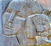 Monument with a portrait of mother and child. Symbol of motherhood and love royalty free stock images
