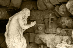 Monument praying elder in a cave Royalty Free Stock Photo