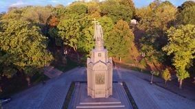 Drone view statue saint Prince Vladimir with christian cross in summer park. Monument Prince Vladimir with cross in Kiev city park. Drone view statue saint stock footage