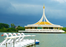 Monument at public park against water wave and blue sky. At Suanluang Rama 9, Thailand Stock Photos
