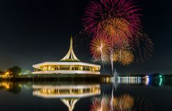 Monument in public park of thailand. And fireworks background in public park, Night light shooting reflection on water concept at the Suanluang Rama 9, Thailand stock images