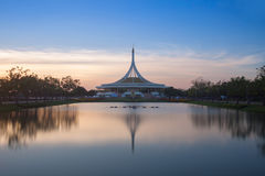 Monument in public park of thailand. Twilight shooting reflection on water concept at the Suanluang Rama 9, Thailand royalty free stock images