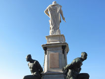 The monument Quattro Mori of the Four Moors in Livorno city . Rear view of the monument against the blue sky . Tuscany, Italy stock image