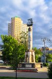 Monument on Riga fountain in the  small park in front of the Rizhskiy Railway Station in Moscow. In the background there is a multistory skyscraper of the hotel Royalty Free Stock Images
