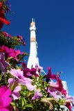 Space rocket in the Samara, View across flowerbed. The Monument of Russian space transport rocket. Samara. Russia.View across petunia flowerbed royalty free stock image