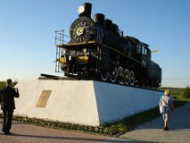 A monument in Salekhard of the Soviet era. The first Soviet locomotive arrived to raise the region stock photos