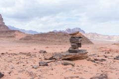 Monument of several stones stacked one upon another in the Wadi Rum desert near Aqaba city in Jordan royalty free stock images