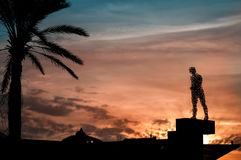 Monument silhouette walking man against Stock Images