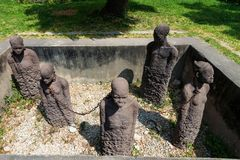 Monument of slaves dedicated to victims of slavery. Sculpture of slaves dedicated to victims of slavery in Stone Town of Zanzibar Stock Images