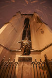 Monument during a snowfall in Lviv. Snow falls on the old monument in the center of the city. Cathedral Gothic cathedral. Lviv. Ukraine Royalty Free Stock Photo