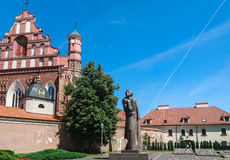 A monument to Adam Mickiewicz and Bernardine Church. Vilnius Stock Photos