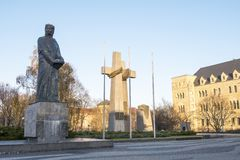 Monument to Adam Mickiewicz and monument to the victims of june 1956 Poznan crosses at Adam Mickiewicz square. Poland. Poznan, Poland - December 05, 2018 stock images
