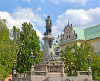 Monument to Adam Mickiewicz in the square. Warsaw, Poland Royalty Free Stock Image