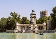 Monument to Alfonso XII in the Buen Retiro Park in Madrid. Pond with boats in historical park of Madrid. stock images