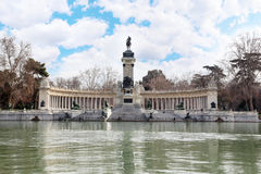 Monument to Alfonso XII and colonnade near pond Royalty Free Stock Image