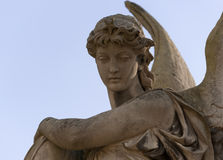 Monument to an angel on a cemetery Royalty Free Stock Image