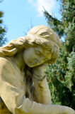 Monument to an angel in a garden Royalty Free Stock Images