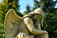 Monument to an angel in a garden. On a sunny day Royalty Free Stock Image