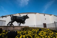 Bullring located in Ronda, Spain. Monument to the bulls in `Puerta 1` door one, in front of the arena of combat stock images