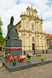 Monument to Cardinal Stefan Wyszynski and rococo Visitationist Church in Warsaw, Poland. Royalty Free Stock Photos