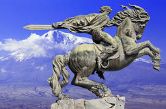 Monument to David of Sasun - hero of armenian epos. Sculpture depicting a rider and his war horse in a rapid burst of rush at the enemy on the background of the Stock Images