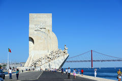 Monument to the Discoveries, Lisbon, Portugal. Monument to the Discoveries (Portuguese: Padrão dos Descobrimentos) and Ponte 25 de Abril at Belem district Royalty Free Stock Photography