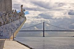 Monument to the Discoveries Padrao dos Descobrimentos at the Tagus river with view on 25th of April Bridge Lisbon - Portugal.  stock photography
