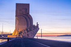 Monument to the Discoveries and 25th of April Bridge in Lisbon Royalty Free Stock Photography