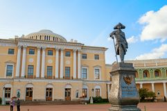 Monument to emperor Paul I in front of Pavlovsk Palace - summer palace of emperor in Pavlovsk, St Petersburg Russia. Pavlovsk, St Petersburg, Russia - September royalty free stock images