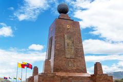 Monument to the Equator. In Quito, Ecuador with the Ecuadorian flag in the bottom left Stock Image