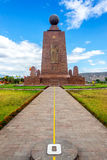 Monument to the Equator. View of the Mitad del Mundo monument to the equator near Quito, Ecuador.  The yellow line divides the southern and northern hemispheres Royalty Free Stock Images