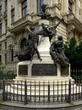 Monument to Eugeniu Carada 1836-1910, founder of The National Bank of Romania,. As seen from Lipscani Street Stock Image