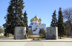 Monument to fallen soldiers and Assumption cathedral. Stock Images