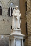 Monument to the famous priest, the learned economist of the 18th century Salustio Bandini on Piazza Tolomei. Siena, Italy Royalty Free Stock Photography