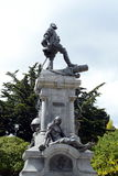 A monument to Fernando Magellan in Punta arenas. Royalty Free Stock Images