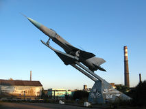 Monument to a fighter aircraft SU-15 at the entrance of the plan. A monument to a interceptor Su-15 at the entrance of a factory against a blue sky. Novokuznetsk Stock Photos