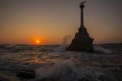 Monument to flooded ships in a storm at sunset. Royalty Free Stock Photography