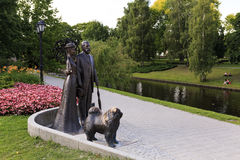 Monument to George Armitstead and Cecilia Pihlau. Riga, Latvia. Monument to George Armitstead with his wife Cecilia Pihlau and their dog chow chow . Opera Square Royalty Free Stock Image