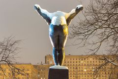 Monument to girl bather back view. Snow on the monument, winter evening in the park stock photography