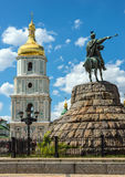 Monument to Hetman Bogdan Khmelnitsky and the bell tower of St. Saint Sophia Cathedral is a cathedral temple of Kiev Metropolis in 1037-1299 and second one Royalty Free Stock Photo
