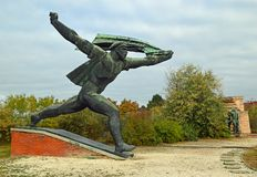 Monument to the Hungarian Socialist Republic 2 Communist Statues at Memento Park Budapest Hungary. USSR Communist soviet style arts and statue. Memento Park, or stock images