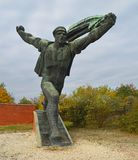 Monument to the Hungarian Socialist Republic 4 Communist Statues at Memento Park Budapest Hungary. USSR Communist soviet style arts and statue. Memento Park, or stock photography