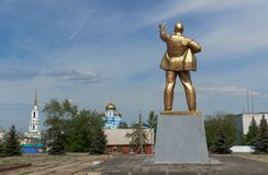 Monument to Lenin   in  Zadonsk town center on  Zadonsky  monastery background.  Lipetsk Oblast, Russia Royalty Free Stock Photos