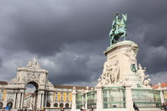 Monument to Manuel I on Palace Square in Lisbon. Against the terrible sky royalty free stock photo