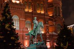 Monument to Marshal Zhukov near the walls of the night Kremlin.  Royalty Free Stock Image