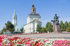 Monument to the master gunsmith Nikita Demidov. Nikita Demidov Monument on the background of blue sky and Nicholas-Zaretsky Church Stock Image